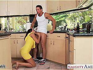 brown-haired wife Rachel Starr taking knob in kitchen