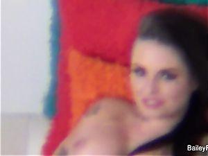 Dahlia Sky observes Christy on set