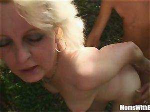 ash-blonde Mama Jana Receives raunchy humping Outdoors